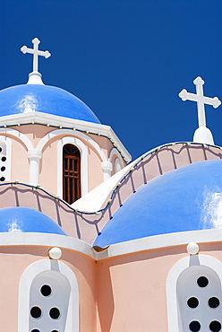 Light pink church, chapel with blue domes in Mykonos City, Cyclades, Greece, Europe