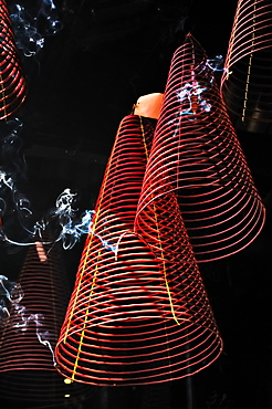 Ascending smoke, red incense steeming spirals in Phuoc An Hoi Quan Pagoda, Ho Chi Minh City, Saigon, Vietnam, Southeast Asia