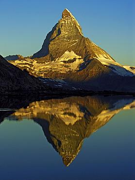 The Matterhorn is reflected in the Riffelsee near Zermatt, canton Wallis, Switzerland