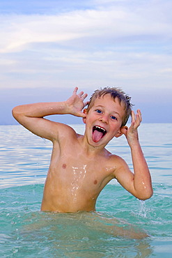 Boy, 6 years old, swimming in the sea, playful
