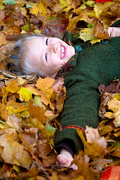 Girl, 7, in a park in autumn