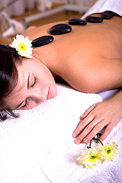 Patient in a physiotherapy practice getting a Hot Stone Massage