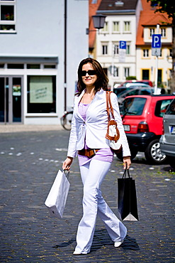 Young woman on a shopping spree in the city