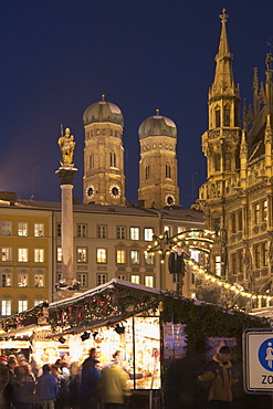 Christmas market on Marien-Place Munich with Marien-clumn townhall and cathedral Bavaria Germany