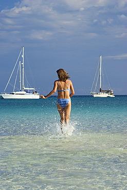 Woman at Cala Brandinchi Beach eastcoast Sardinia Italy