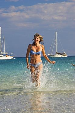 Woman at Cala Brandinchi Beach, eastcoast, Sardinia, Italy