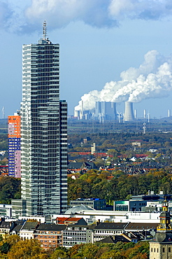 Kölnturm tower in the Mediapark, Neurath coal-fired power plant of RWE at the back, Grevenbroich, Cologne, North Rhine-Westphalia, Germany, Europe