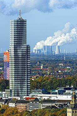 Kölnturm tower in the Mediapark, Neurath coal-fired power plant of RWE at the back, Grevenbroich, Cologne, North Rhine-Westphalia, Germany, Europe