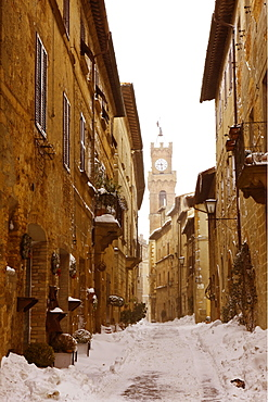 Snow-covered road in Pienza, Tuscany, Italy, Europe