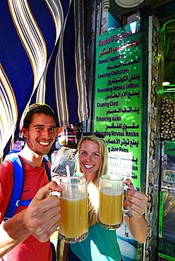 Tourist drink sugarcane-syrop, Al Balat, Amman, Jordan, Asia