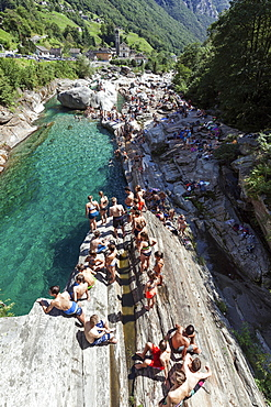 Bathing people on rocks at Verzasca, near Lavertezzo, Verzascatal, Valle Verzasca, Canton Ticino, Switzerland, Europe