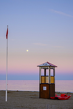 Rescue tower and rescue boat on the beach, evening mood, Adriatic Sea, Italy, Europe