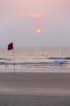 Lifeguard flag in sunset at Agonda Beach, Goa, India, Asia