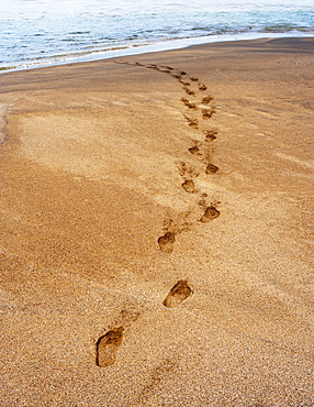 Footprints in the sand, beach of Playa de la Solapa in Ajuy, Fuerteventura, Canary Islands, Spain, Europe