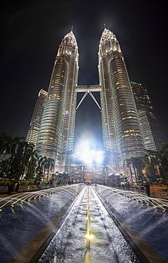 Fountain in front of illuminated Petronas Twin Towers at night, Kuala Lumpur, Malaysia, Asia