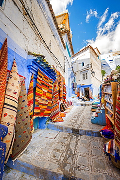 Narrow alley, carpet and craft shop, blue houses, medina of Chefchaouen, Chaouen, Tangier-Tétouan, Morocco, Africa