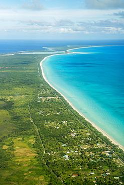 Coastline with beach and village, Ouvea island, New Caledonia, Oceania