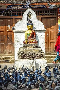 Buddha statue at Kathesimbhu Stupa, doves, Kathmandu, Himalaya region, Nepal, Asia