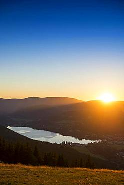 View from Hochfirst to Lake Titisee and Feldberg mountain at sunset, near Neustadt, Black Forest, Baden-Wuerttemberg, Germany, Europe
