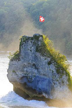 Vantage point, rock at the Rhine Falls with Swiss flag, Schaffhausen, Switzerland, Europe