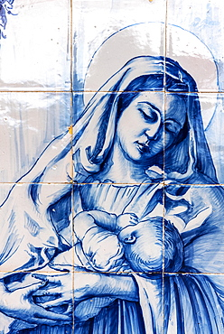 Mother breast-feeding her child, historical tile picture made of Azulejo tiles, painted ceramic tiles, Funchal, Madeira, Portugal, Europe