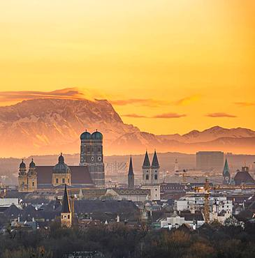 View over Munich with Church of Our Lady, Theatine Church, Ludwigskirche, behind Zugspitze at sunset, Munich, Bavaria, Germany, Europe