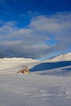 Refuge in snow-covered landscape at Snaefellsjoekull, Snaefellsnes Peninsula, Vesturland, Iceland, Europe