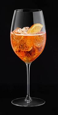 Aperol Spritz in glass, cutout, black background, Germany, Europe