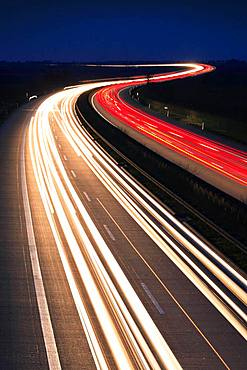 Light tracks on the A14 motorway at night, near Halle an der Saale, Saxony-Anhalt, Germany, Europe
