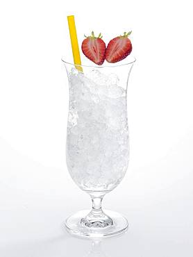 Glass prepared for cocktail, decorated with strawberries, drinking straw, crushed ice, Germany, Europe