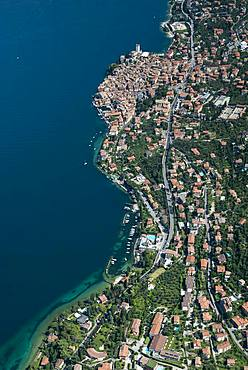 Malcesine with old town and Castello di Malcesine on Lake Garda, aerial view, Province of Veneto, Italy, Europe