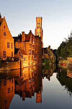 Illuminated historical houses with water reflection at dusk, Rozenkaai, Kanal Dijver, blue hour, Bruges, Belgium, Europe