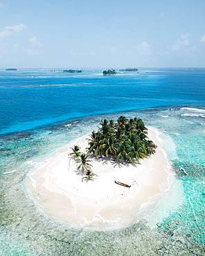Small tropical Palm Island, Paradise, drone shot, San Blas, Guna Gala, Panama, Central America