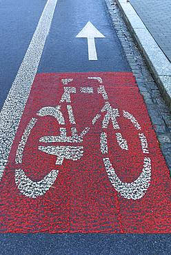 Red marked bicycle path on the roadway, Krakow, Poland, Europe