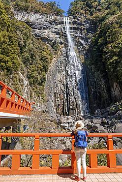 Tourist looks at Nachi Waterfall at Seigantoji Temple, Nachisan, Wakayama, Japan, Asia