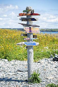 Direction sign in different directions, distance indicator, Cape Forchu, Yarmouth, Nova Scotia, Canada, North America