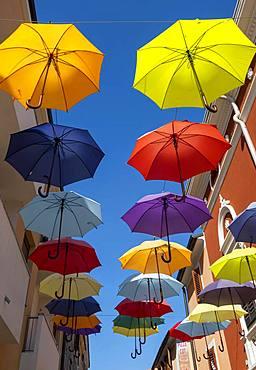 Colorful umbrellas over a road, Novigrad, Istria, Croatia, Europe