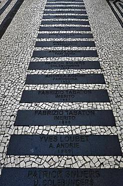 Walk of Fame with the names of famous rally drivers of the Madeira Wine Rally, black and white ornamental floor mosaic made of cobblestones, Funchal, Madeira Island, Portugal, Europe