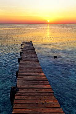 Boat jetty, wooden jetty in the sea at sunset, Selayar Dive Resort, Selayar Island, South Sulawesi, Sulawesi, Indonesia, Asia