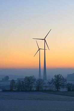 Wind power plants, silhouettes in dawn, Swabian Alb, Baden-Wuerttemberg, Germany, Europe