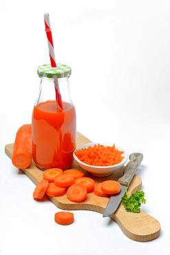 Carrot juice in bottle and carrot slices, Germany, Europe