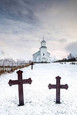 Cemetery with graves and church of Gimsoy, Gimsoykirke, Gimsoy, Lofoten, Norway, Europe
