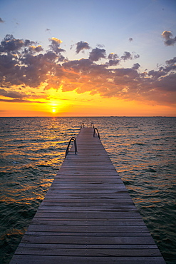 Footbridge at sunrise over the sea, Amager Strand, Copenhagen, Denmark, Europe