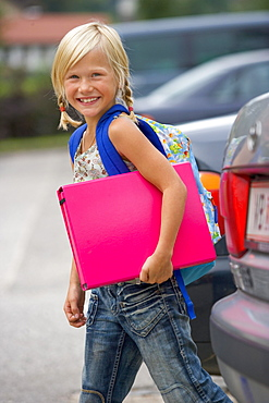 Girls on their way to school in road traffic, Upper Austria, Austria, Europe