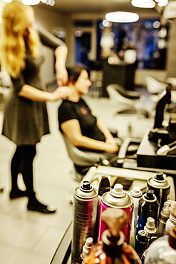 Cans of hairspray in a hairdressing salon, Hairdresser is doing the hair of a customer, North Rhine-Westphalia, Germany, Europe