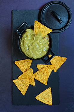 Guacamole in pot and tortilla chips