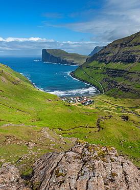 Overlooking Tjornuvik or Tjornuvik, Streymoy, behind spiers Risin og Kellingin in front of cliff Eioiskollur, Faroe Islands, Foroyar, Denmark, Europe