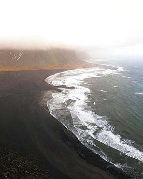 Stokksnes Beach from the air with clouds, lava sand beach, Vestrahorn, Iceland, Europe