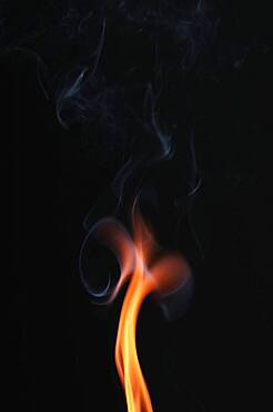 Smoke from a burnt match against a dark background, studio recording, Germany, Europe
