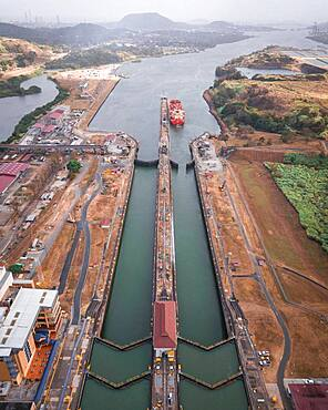 Aerial view, cargo ship at the lock in the Panama Canal from above, Mirador Miraflores, Panama, Central America